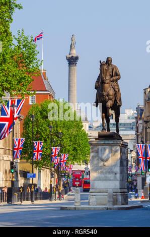 UK, England, London, Whitehall and Nelson's Column on Trafalgar Square, Union Jack Flags - Stock Image