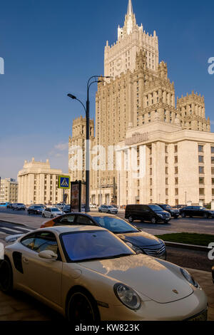 Porsche car parked near the Ministry of Foreign Affairs of Russia main building, Smolenskaya-Sennaya pl, showing - Stock Image