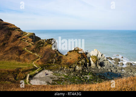 The South West Coast Path and Tarka Trail and rocky cove near Lee Bay, Ilfracombe North Devon, England, UK, Britain - Stock Image