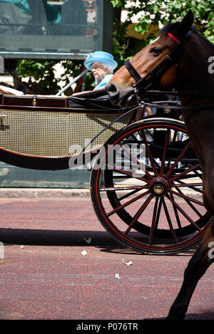Trooping the Colour 2018. The Queen, in carriage running over broken chine from cup thrown by protester - Stock Image