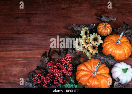 Thanksgiving decor with candle, pine cones, sunflowers, acorns, pumpkins, squash, guard, berries and  leaves - Stock Image