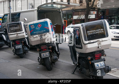 Pizza delivery motorcycles parked in Prahran, Melbourne, Australia - Stock Image