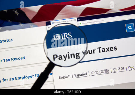 MONTREAL, CANADA - APRIL 24, 2019 : IRS Pying your Taxes and Refunds USA Government web pages under magnifying glass. IRS.com is an official web site  - Stock Image
