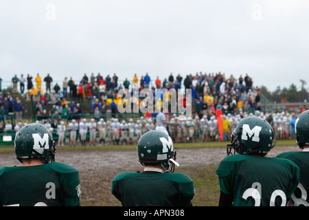 High School Football Players on Sidelines - Stock Image