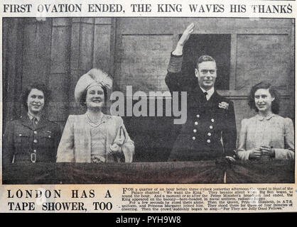 British newspaper of Royal Family with King George VI & Queen & daughters Elizabeth, Margaret greet crowd at end of the war after VE Day on 9 May 1945 - Stock Image