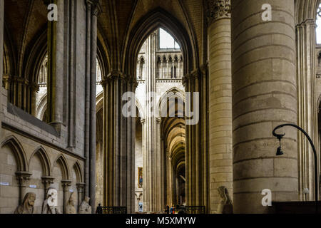 The solemn interior of the Rouen Cathedral in the Normandy region of Rouen France with it's massive vaults - Stock Image