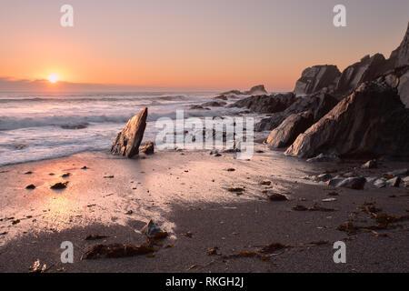 Sunset Arymer Cove Devon Uk - Stock Image