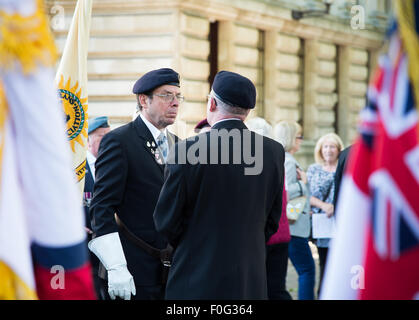 Portsmouth, UK. 15th Aug, 2015. Veterans prepare in advance of the VJ Day 70th anniversary memorial at the Cenotaph - Stock Image