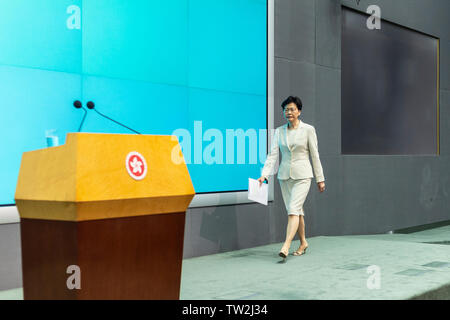 Hong Kong Chief Executive Carrie Lam arrives to speak at a press conference at the government headquarters in Hong Kong. Carrie Lam apologised for the political unrest sparked by a proposed Beijing-backed law that would have allowed extraditions to mainland China. - Stock Image