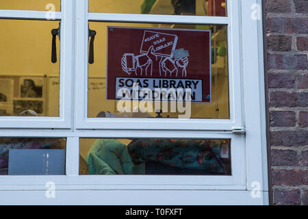 London, UK. 18th March, 2019. A poster in a window of SOAS University of London referring to the Save SOAS Library campaign. Students have been protes - Stock Image