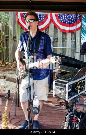 Captiva Island Florida The Mucky Duck restaurant outdoor bar man musician playing guitar singing entertainer - Stock Image