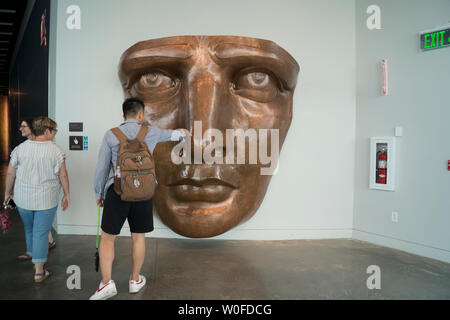 A copper replica of the Statue of Liberty's face is in the Statue of Liberty Museum in the room with her original torch. June 25, 2019 - Stock Image