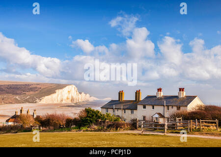 The Seven Sisters, Sussex, England, UK, and the famous coastguard cottages. - Stock Image