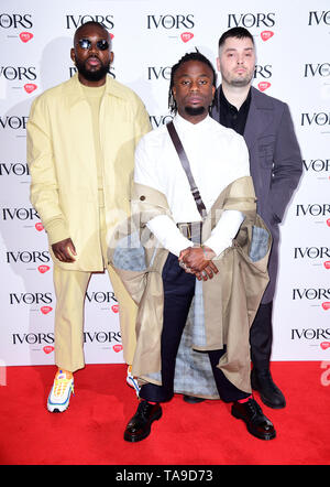 Graham Hastings, Kayus Bankole and Alloysious Massaquoi during the Annual Ivor Novello Songwriting Awards at Grosvenor House in London. - Stock Image