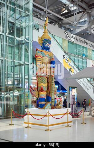 Large Yaksha statue in Suvarnabhumi Airport lobby in Bangkok, Thailand. - Stock Image