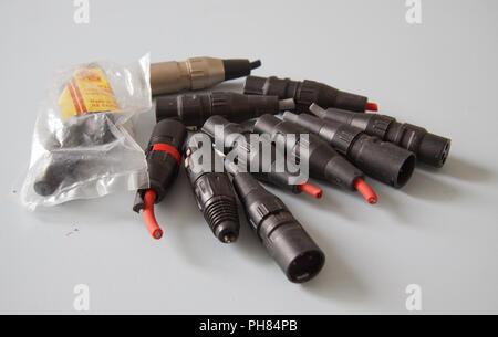 Mostly black XLR audio connectors - Stock Image