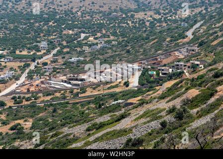 Plaka, Crete, Greece. June 2019, New build construction site for new properties on the mountanside above Plaka, Crete. - Stock Image