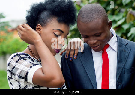 Young couple of business people looking at something together outdoors - Stock Image