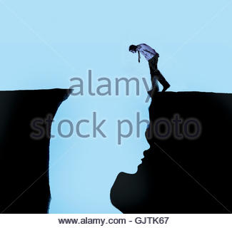 Man looking inside of woman's head outlined in chasm - Stock Image