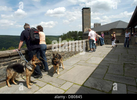 Visitors are pictured on a terrace of the Ordensburg Vogelsang castle at national park Eiffel, Gemuend, Germany, - Stock Image