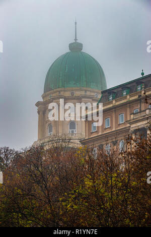 Budapest, Hungary - The famous Buda Castle Royal Palace on a foggy autumn morning - Stock Image