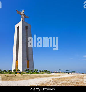 Cristo-Rei statue on the Cristo Rei or King Christ Sanctuary in Almada. The second most visited sanctuary in Portugal, and a landmark of Lisbon - Stock Image