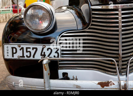 Cuba, Havana. Close-up of classic car's front grille and headlight. Credit as: Wendy Kaveney / Jaynes Gallery / DanitaDelimont.com - Stock Image