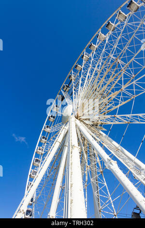 The Wheel of Liverpool ferris wheel ride, sited next to Duke's Dock and adjacent to the M&S Bank Arena (formerly the Echo Arena) on the Liverpool wate - Stock Image