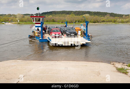 Cable ferry ship berthing, course to Kazimierz Dolny from Janowiec in Poland, Europe, passenger local floating bridge. - Stock Image