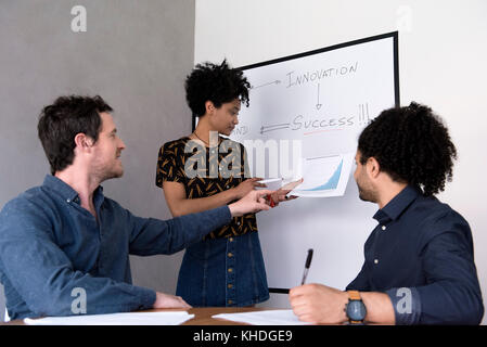 Student asking teacher question - Stock Image