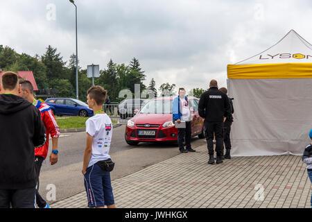Bielsko-Biala, Poland. 12th Aug, 2017. International automotive trade fairs - MotoShow Bielsko-Biala. People standing at the entrance to the motoshow. Credit: Lukasz Obermann/Alamy Live News - Stock Image