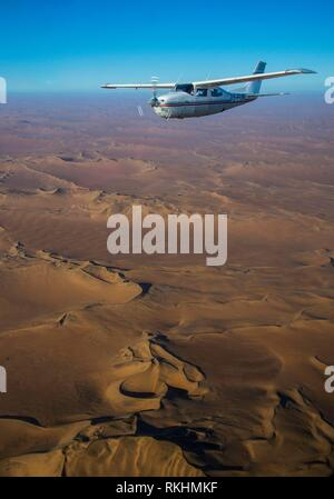 Airplane flying above the Namib desert, Namibia - Stock Image