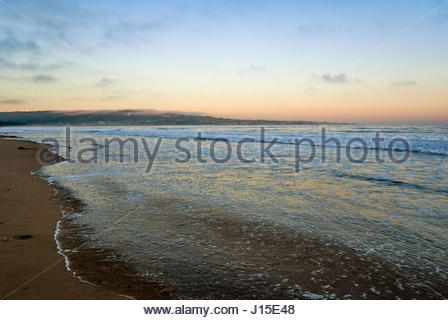 Monterey Peninsula and Cannery Row as seen from Del Monte Beach in early morning - Stock Image