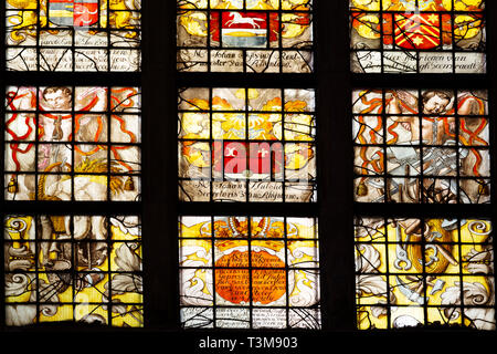 Stained glass window in the St Bavo Church in Haarlem, the Netherlands. The place of worship is located at the Grote Markt. - Stock Image