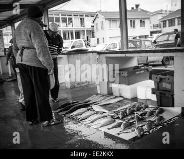 Fish seller at Kalk Bay, Cape Peninsular, Cape Town, South Africa selling locally-caught fish.  Black and white - Stock Image