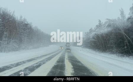 Russian winter, snowstorm on the road, dangerous driving - Stock Image