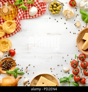 Pasta with ingredients sweet basil ,tomato ,garlic ,parsley ,bay leaves ,pepper  and cheese on white wooden background. - Stock Image