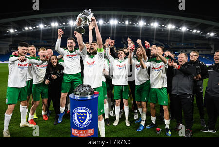 Bognor lift the trophy after winning the Sussex Senior Challenge Cup Final between Bognor Regis Town and Burgess Hill Town at the Amex Stadium. Credit : Simon Dack - Stock Image