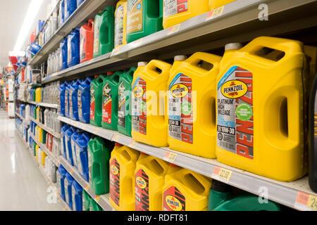 Motor oil bottles on shelves at Walmart store - USA - Stock Image