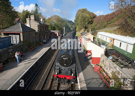 Steam train arriving at the railway station Goathland North York Moors North Yorkshire England UK United Kingdom GB Great Britain - Stock Image
