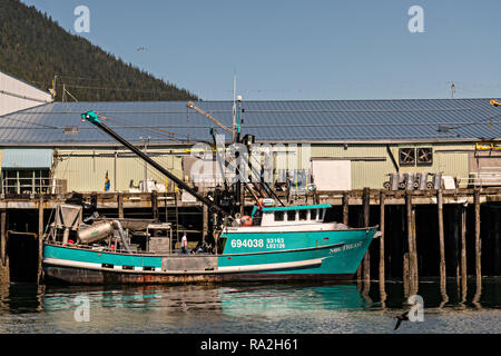 A fishing boat tied to the Icicle Seafoods dock in the tiny village of Petersburg on Mitkof Island along the Wrangell Narrows in Frederick Sound on Mitkof Island, Alaska. Petersburg settled by Norwegian immigrant Peter Buschmann is known as Little Norway due to the high percentage of people of Scandinavian origin. - Stock Image