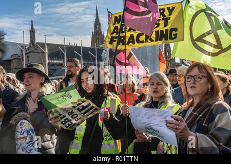 London, UK. 31st October 2018. Protesters at the Extinction Rebellion protest in Parliament Square join in the reading the Delaration of Rebellion' against the British Government for its criminal inaction in the face of climate change catastrophe and ecological collapse. Credit: Peter Marshall/Alamy Live News - Stock Image