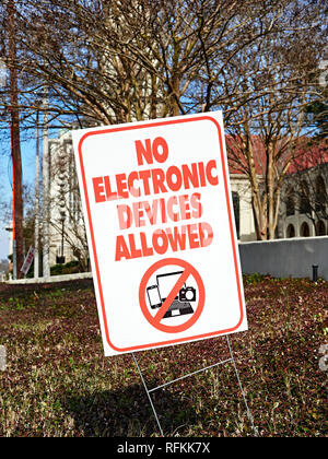 No electronic devices allowed warning sign or caution sign. - Stock Image
