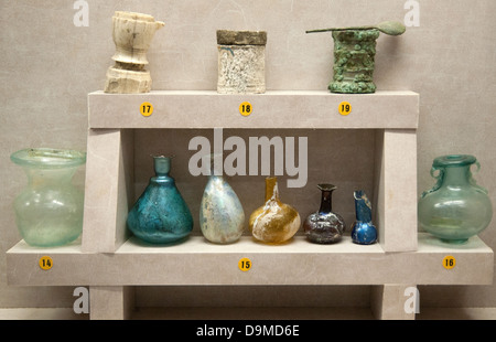 Roman artefacts in the Rolin Museum Autun France include glass arybaales perfume bottles phials and boxes or cases - Stock Image