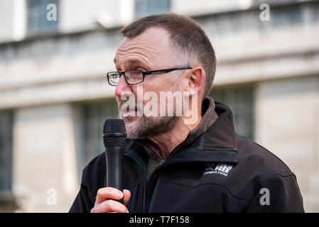 Dr Mark Jones, head of polices for Born Free Corporation, at the London March Against Trophy Hunting and Extinction opposite Downing Street, London. - Stock Image