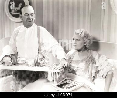 Couple quarreling over breakfast in bed - Stock Image
