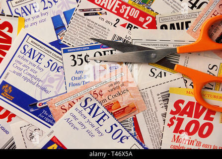 Scissors and Coupons for Savings, USA - Stock Image