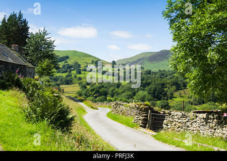 Newlands valley Cumbria, looking south-west from Littletown down the length of an unclassifed road towards High Snab Bank. - Stock Image