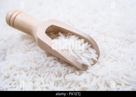 A Wooden Kitchen Scoop On A Pile Of Rice - Stock Image