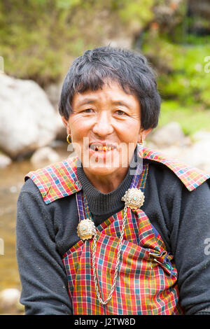 Traditionally dressed woman in Bhutan - Stock Image